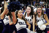 Yale Bulldogs cheerleaders celebrate after their team defeat the Baylor Bears during the first round of the 2016 NCAA Men's Basketball Tournament at...
