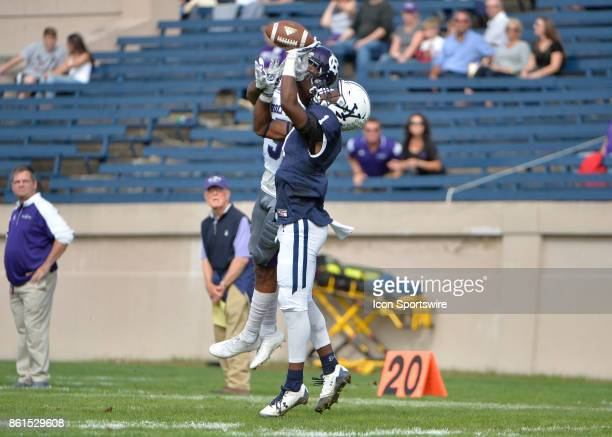 Yale Bulldogs defensive back Malcolm Dixon and Holy Cross Crusaders wide receiver Blaise Bell attemps to receive the ball during the game between the...
