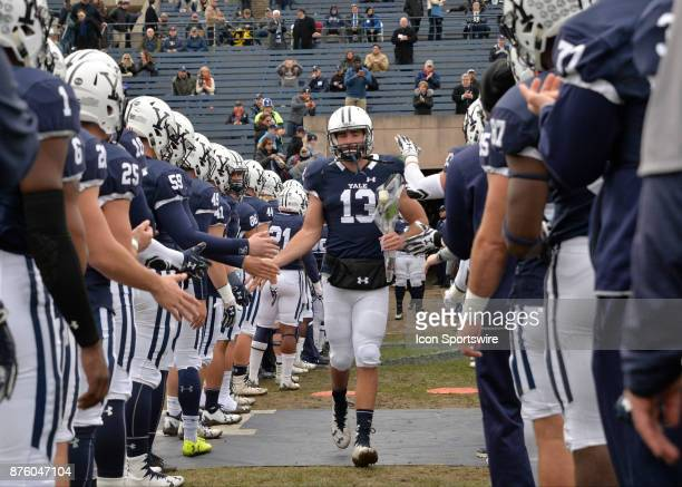 Yale Bulldogs quarterback Stephen Barmore heads to the field during Senior night celebrations prior to the start of the game between the Yale...
