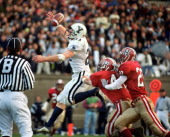 Yale University's wide receiver Eric Johnson hauls in a touchdown pass deep in the end zone behind Harvard University's defenders Mike Cataldo and...