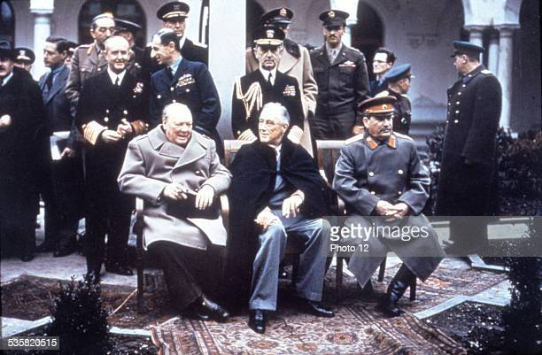 Yalta Conference Churchill Roosevelt and Stalin in the foreground Admiral D Leahy sir A Cunningham On the left E Estattinius and Molotov can be seen...