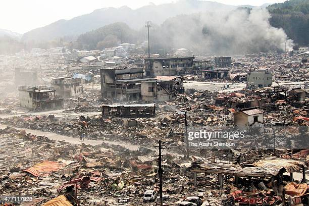 Yamada City devastated by the tsunami after a 90 magnitude strong earthquake and subsequent fire is seen on March 14 2011 in Yamada Iwate Japan The...