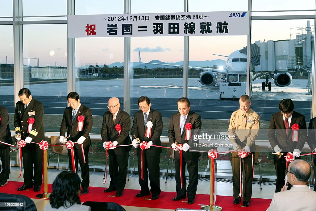 Yamaguchi Prefecture Governor Shigetaro Yamamoto (3L) and guests attend the opening ceremony of the Iwakuni-Kintaikyo Airport on December 13, 2012 in Iwakuni, Yamaguchi, Japan. The 98th airport in Japan, will share the runway with U.S. Army Iwakuni Base.