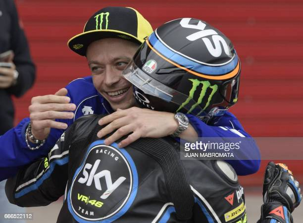 Yamaha biker Valentino Rossi of Italy greats Andrea Migno in KTM after finishing the Moto3 race of Argentina Grand Prix at Termas de Rio Hondo...