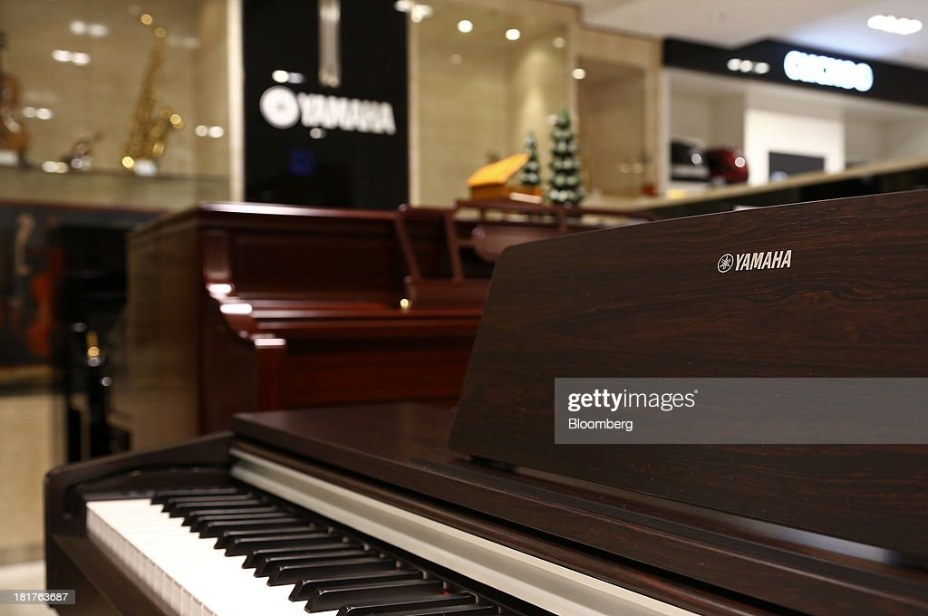 Yamaha Corp. pianos sit on display at a Shinsegae Co. department store in Seoul, South Korea, on Tuesday, Sept. 24, 2013. The South Korean economy faces headwinds, with record household debt and a sluggish housing market weighing on consumption. Photographer: SeongJoon Cho/Bloomberg via Getty Images