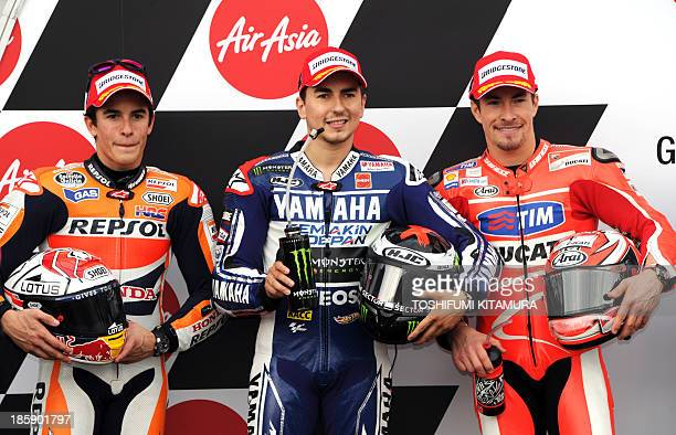 Yamaha Factory Racing rider Jorge Lorenzo of Spain poses with Repsol Honda team rider Marc Marquez of Spain and Ducati team rider Nicky Hayden of US...