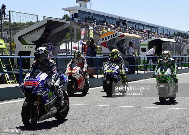 Yamaha Factory Racing's Spanish rider Jorge Lorenzo Energy TI Pramac Racing's Colombian rider Yonny Hernandez Yamaha Factory MotoGP's Italian rider...