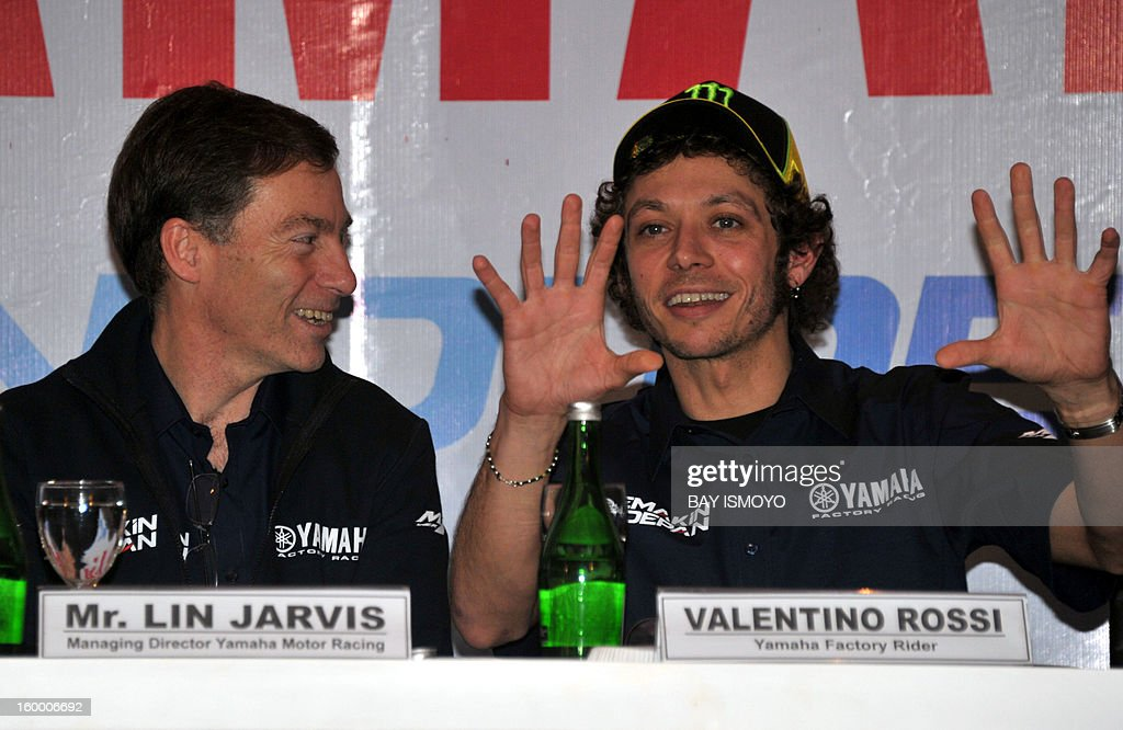 Yamaha Moto GP rider Valentino Rossi (R) gestures during a press conference in Jakarta on January 25, 2013 as managing director of Yamaha motor racing Lin Jarvis (L) looks on. Rossi and his teammate Jorge Lorenzo (not pictured) were in Jakarta to promote Indonesian Yamaha's new slogan-logo, semakin di depan (getting ahead). AFP PHOTO / Bay ISMOYO