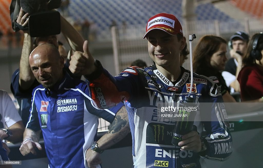Yamaha MotoGP rider Jorge Lorenzo of Spain celebrates after taking the pole position during a qualifying practice session part of the Qatar Grand Prix on April 6, 2013 at the Losail International Circuit in the Qatari capital Doha.