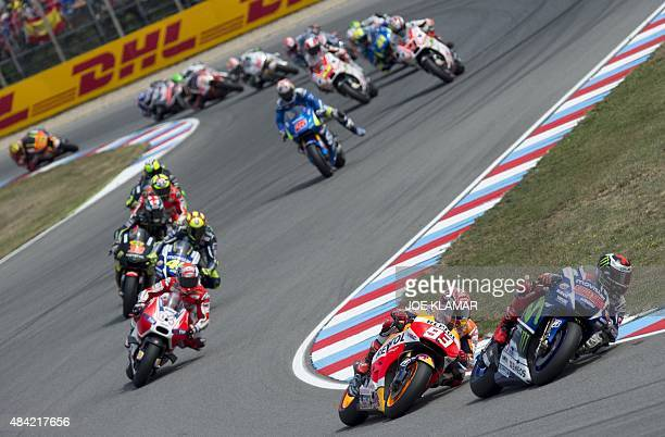 Yamaha MotoGP's Spanish rider Jorge Lorenzo and Repsol Honda Team's Spanish rider Marc Marquez lead the pack as they compete during the Moto GP Czech...