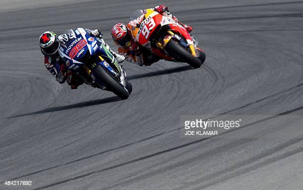 Yamaha MotoGP's Spanish rider Jorge Lorenzo and Repsol Honda Team's Spanish rider Marc Marquez compete during the Moto GP Czech Grand Prix in Brno...