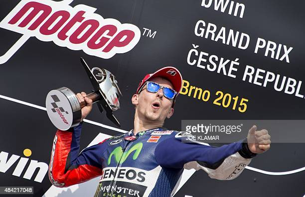 Yamaha MotoGP's Spanish rider Jorge Lorenzo celebrate his victory on the podium after the Moto GP Czech Grand Prix in Brno Czech Republic on August...