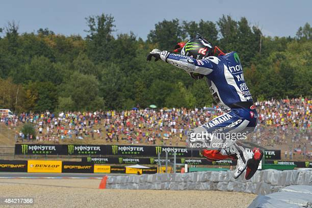 Yamaha MotoGP's Spanish rider Jorge Lorenzo celebrates after the Moto GP Czech Grand Prix in Brno Czech Republic on August 16 2015 Yamaha MotoGP's...