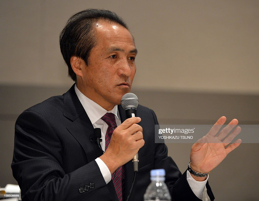 Yamaha Motor president Hiroyuki Yanagi announces the company's new mid-term business strategy in Tokyo on December 18, 2012. Yamaha is expecting to introduce the new concept vehicle and unmanned autonomous vehicle system in the next year. AFP PHOTO / Yoshikazu TSUNO