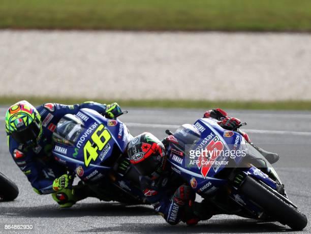 Yamaha rider Maverick Vinales of Spain and Yamaha rider Valentino Rossi of Italy negotiate a corner during the Australian MotoGP Grand Prix at...
