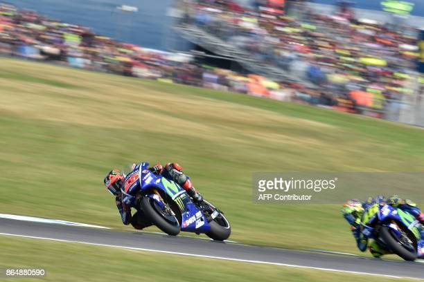 Yamaha rider Maverick Vinales of Spain races ahead of teammate Valentino Rossi of Italy during the Australian MotoGP Grand Prix at Phillip Island on...