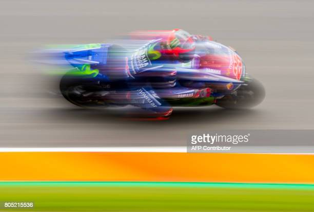 Yamaha rider Spanish Maverick Vinales steers his bike during the training session of the Moto Grand Prix of Germany at the Sachsenring Circuit on...