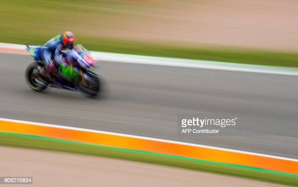 TOPSHOT Yamaha rider Spanish Maverick Vinales steers his bike during the training session of the Moto Grand Prix of Germany at the Sachsenring...