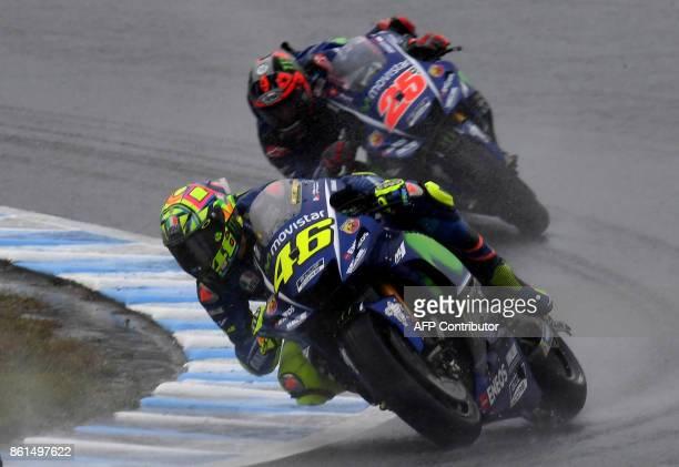 Yamaha rider Valentino Rossi of Italy leads Yamaha rider Maverick Vinales of Spain during the MotoGP Japanese Grand Prix at Twin Ring Motegi circuit...