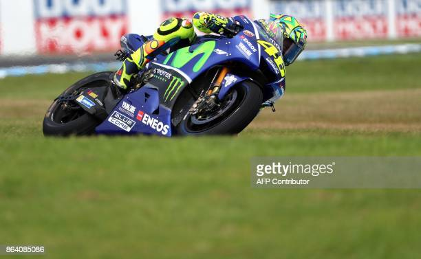 Yamaha rider Valentino Rossi of Italy powers his machine during the third practice session of the Australian MotoGP Grand Prix at Phillip Island on...