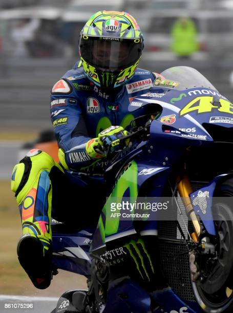 Yamaha rider Valentino Rossi of Italy shows off his skill doing a wheelie at the end of the third practice round of the MotoGP Japanese Grand Prix at...