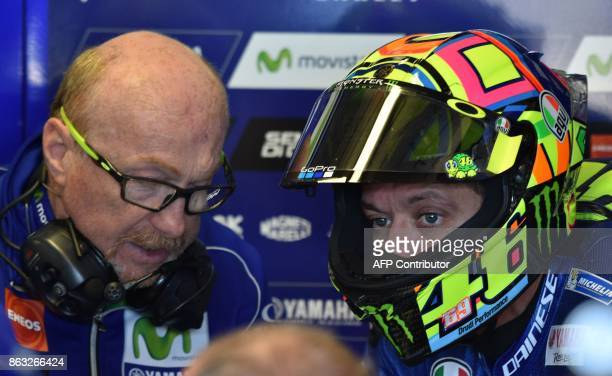Yamaha rider Valentino Rossi of Italy speaks to his pit crew during the first practice session of the Australian MotoGP Grand Prix at Phillip Island...