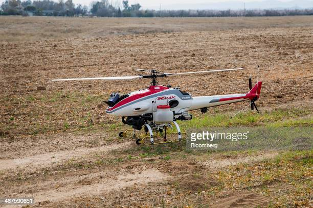 A Yamaha RMax Unmanned Aerial Vehicle sits before a crop dusting test flight at a University of California Davis test facility in Arbuckle California...