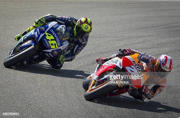 Yamaha Team's Italian rider Valentino Rossi and Repsol Honda's Spanish rider Dani Pedrosa compete during the Moto GP race of the Aragon Grand Prix at...