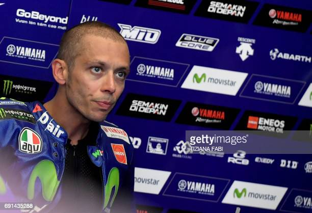 Yamaha team's Italian rider Valentino Rossi is pictured in the box during the Free Practice session ahead of the Italian motorcycling Grand Prix at...