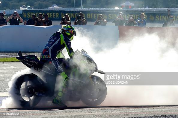 Yamaha Team's Italian rider Valentino Rossi performs a burnout after the Moto GP race of the Motul Comunidad Valenciana Grand Prix at the Ricardo...