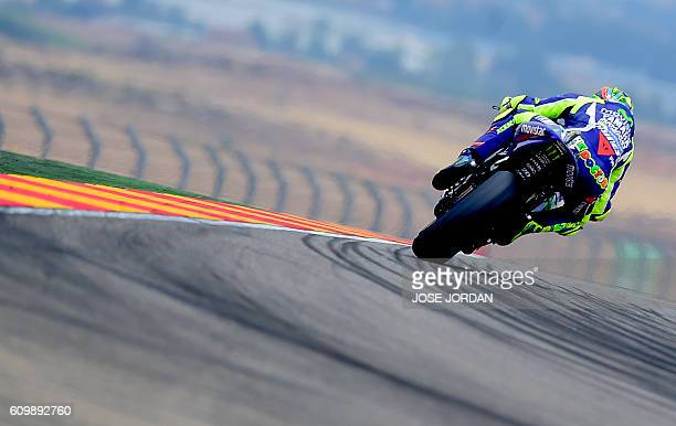 Yamaha Team's Italian rider Valentino Rossi rides during the Moto GP second practice session ahead of the Aragon Grand Prix at the Motorland...