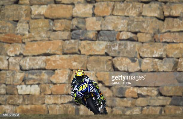 Yamaha Team's Italian rider Valentino Rossi takes part in the third MotoGP free practice session ahead of the Aragon Grand Prix at the Motorland...