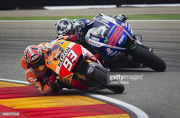 Yamaha Team's Spanish rider Jorge Lorenzo and Repsol Honda's Spanish rider Marc Marquez compete in the MotoGP race Aragon Grand Prix at the Motorland...