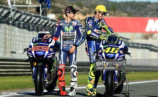 TOPSHOT Yamaha Team's Spanish rider Jorge Lorenzo and Yamaha Team's Italian rider Valentino Rossi get preparedbefore posing with the nine pilots that...