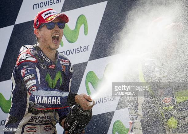 Yamaha Team's Spanish rider Jorge Lorenzo celebrates on the podium after winning the Moto GP race of the Aragon Grand Prix at the Motorland racetrack...