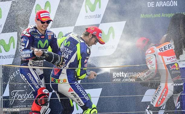 Yamaha Team´s Spanish rider Jorge Lorenzo celebrates with Yamaha Team´s Italian rider Valentino Rossi and Repsol Honda's Spanish rider Dani Pedrosa...