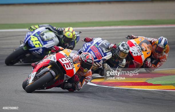 Yamaha Team's Spanish rider Jorge Lorenzo Repsol Honda's Spanish rider Marc Marquez Repsol Honda's Spanish rider Dani Pedrosa and Yamaha Team's...