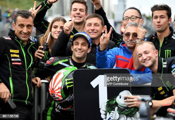 Yamaha Tech3 rider Johann Zarco of France celebrates his pole position with team officers at the parc ferme after the qualifying session of the...