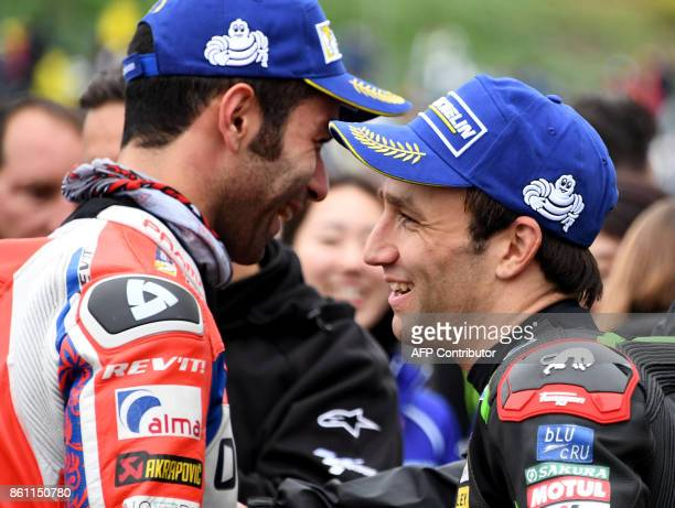 Yamaha Tech3 rider Johann Zarco of France chats with Ducati rider Danilo Petrucci of Italy at the parc ferme after the qualifying session of the...