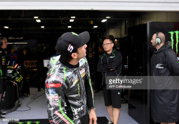 Yamaha Tech3 rider Johann Zarco of France checks weather prior to the first practice round of the MotoGP Japanese Grand Prix at Twin Ring Motegi...