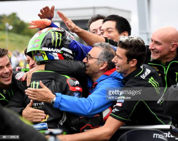 Yamaha Tech3 rider Johann Zarco of France is congratulated for his pole position by team officers at the parc ferme after the qualifying session of...