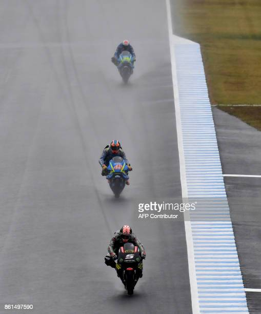 Yamaha Tech3 rider Johann Zarco of France leads Suzuki rider Alex Rins of Spain and Suzuki rider Andrea Iannone of Italy at the downhill straight...