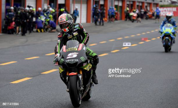 Yamaha Tech3 rider Johann Zarco of France leaves his pit for the qualifying session of the MotoGP Japanese Grand Prix at Twin Ring Motegi circuit in...