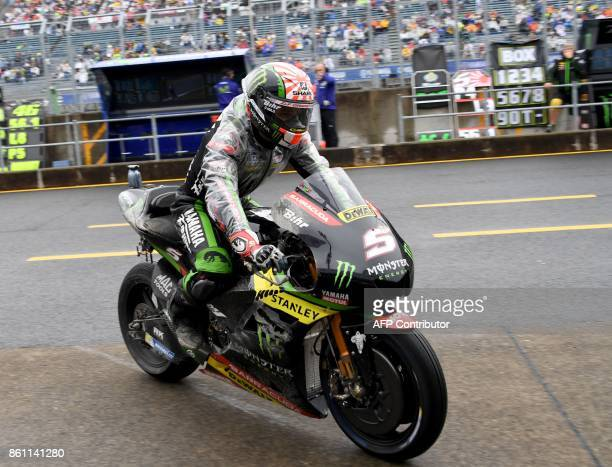 Yamaha Tech3 rider Johann Zarco of France returns to his pit after recovering from offthecourse during the fourth practice round of the MotoGP...