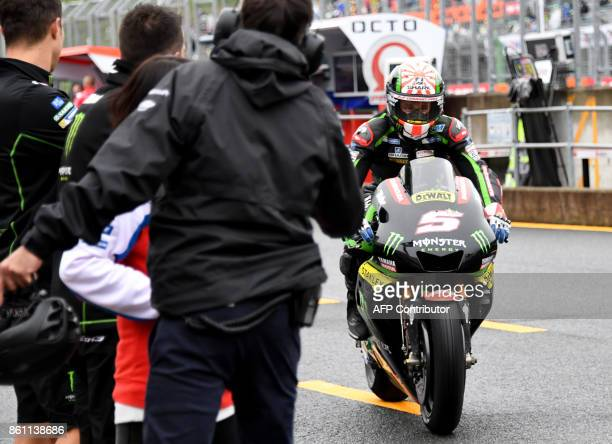 Yamaha Tech3 rider Johann Zarco of France returns to the parc ferme after the qualifying session of the MotoGP Japanese Grand Prix at Twin Ring...