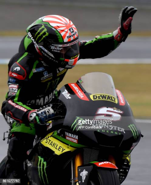 Yamaha Tech3 rider Johann Zarco of France waves to fans at the end of the third practice round of the MotoGP Japanese Grand Prix at Twin Ring Motegi...
