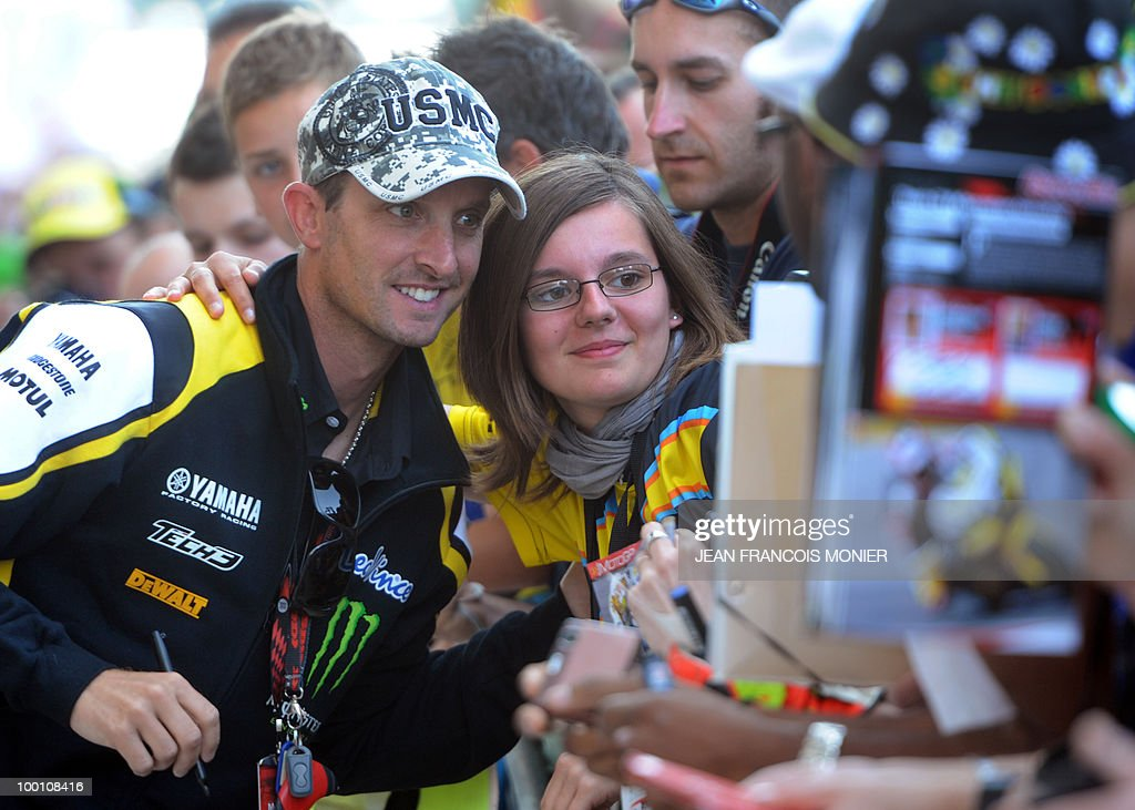Yamaha Tech3's US rider Colin Edwards poses for fans at Le Mans circuit on May 21, 2010, two days ahead of the MotoGP French Grand Prix.