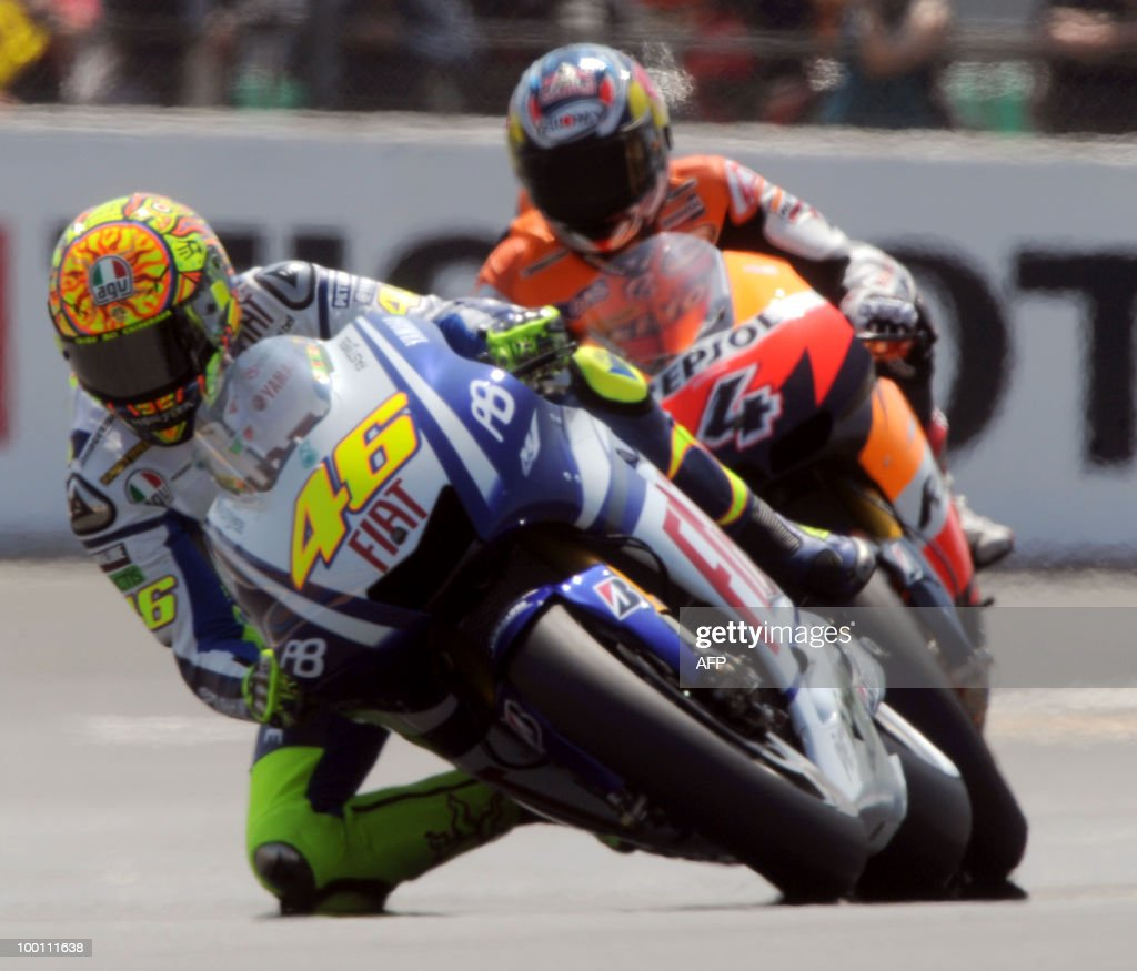 Yamaha's Italian rider Valentino Rossi (L) takes a curve ahead of Honda Repsol's Italian rider Andrea Dovizioso at Le Mans' circuit during a free practice session on May 21, 2010 two days ahead of the MotoGP French Grand Prix.