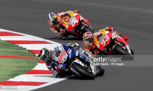 Yamaha's Jorge Lorenzo leads Repsol Honda riders Marc Marquez and Dani Pedrosa during the Moto GP Hertz British Grand Prix at Silverstone...