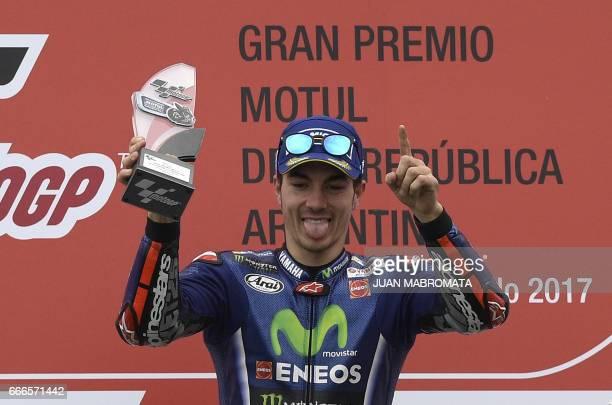 Yamaha's Spanish biker Maverick Vinales celebrates on the podium winning the MotoGP race of the Argentina Grand Prix at Termas de Rio Hondo circuit...